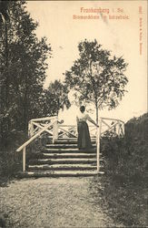 Black and White photo of a woman on stairs outside early 1900's German