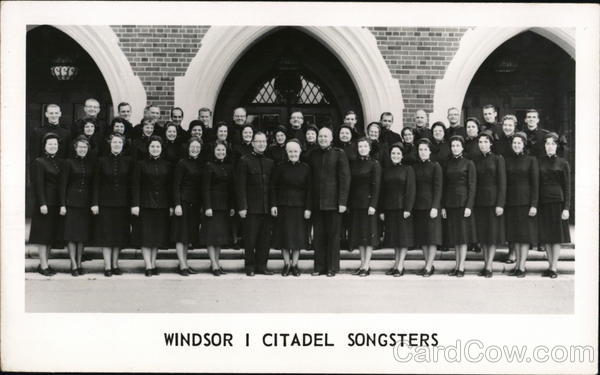 Windsor I Citadel Songsters (Salvation Army) pose in front of a church Canada