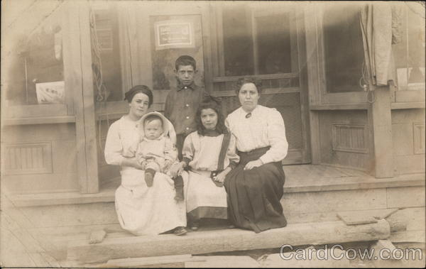 Women Sitting In Front of Shop with Children Wakefield Michigan