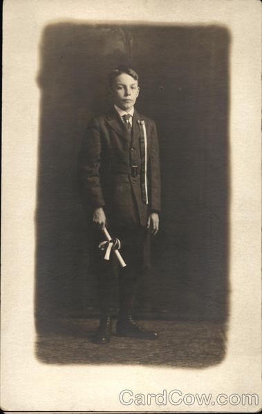 Young Boy dressed in suit holding diploma - early 1900's Photo