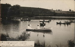 People in row boats in the water at Williams Landing - 1907 Photo by PH Kellogg