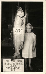 Young girl poses with huge 57 pound Fish Canadian Fish & Cold Storage Co.