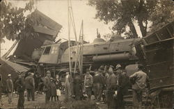 People standing next to a train that has been wrecked