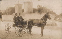 Two Men in Horse Drawn Cart