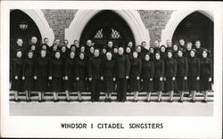 Windsor I Citadel Songsters (Salvation Army) pose in front of a church