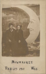 Milwaukee Couple Sitting on Paper Moon Prop, 1911