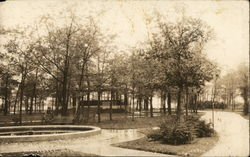 View of the fountain and picnic area of Rietz park, Manistee, MI, 1921