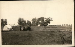 Two tents in a large field, Old Car
