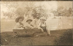 Three Children in Wagon