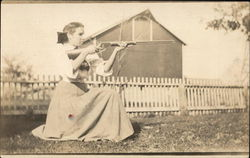 Woman Aiming a Winchester Rifle