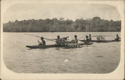 Men in Outrigger Canoes