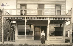 Young Woman stands in store front - Almira Harvey - July 14, 1915