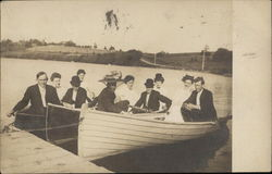 A group of people in three Row boats Circa 1909