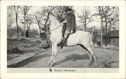 Man on white Horse FP Ranch. Oklahoma (Woolaroc)