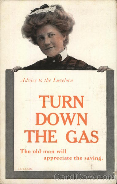 woman holding sign: Advice to the lovelorn turn down the gas the old man will appreciate the saving