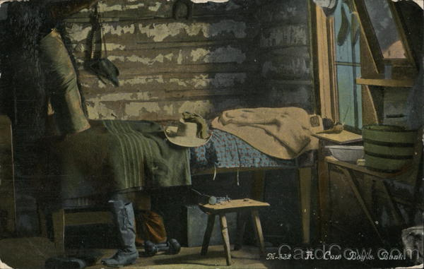 A cowboy's bunk - hat on a bed with boots next to it