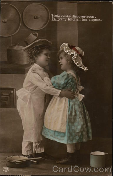 A Boy and Girl Embrace in the Kitchen Children