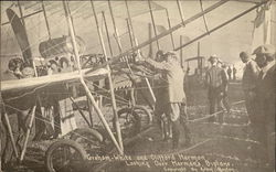 Graham-White and Clifford Harmon Looking over Harman's Biplane