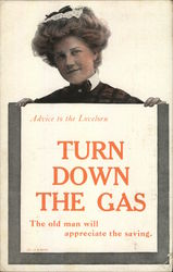woman holding sign: Advice to the lovelorn turn down the gas the old man will appreciate the saving Postcard