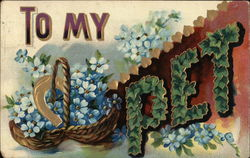 Basket of Blue Flowers and the word Pet Spelled in Green Leaves