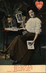 Leap Year 1912 - Woman at table holding pictures