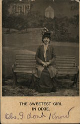 The Sweetest Girl in Dixie - woman sitting on a bench