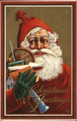 Christmas Greetings - Santa holding toys