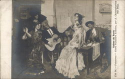 Man Playing Guitar while Two Dressed Up Women Pose