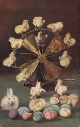 Chicks and a bunny with eggs near a fan