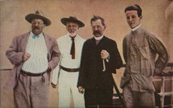 Four Men Standing Next to Each Other