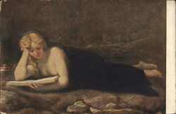 Woman laying on the floor reading