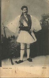 Moustached Man With Walking Stick and Weapons Wearing a Skirt