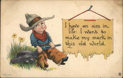 I have an aim in life: I want to make my mark in this old world. Little cowboy with rifle on rock Postcard