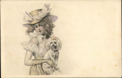 Woman holding a white dog