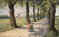 boy and girl walking arm and arm down a tree lined lane