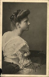 Profile of Seated Woman in White Dress and Single Pearl Strand