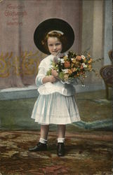 Girl in a hat holding flowers