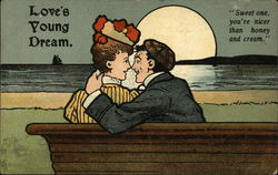 Love's Young Dream - couple kissing on the beach in the moonlight