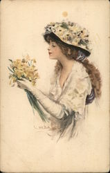 Woman smelling a bouquet of flowers
