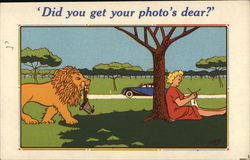 Did you get your photo's dear? - Lion bringing a camera back to a woman