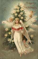 A Merry Christmas - Angels in front of a a tree