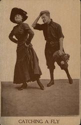 catching a fly - woman and baseball player posing