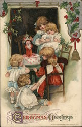 Christmas Greetings - children with a Christmas cake