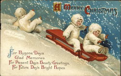 A Merry Christmas - children sledding, one falling off
