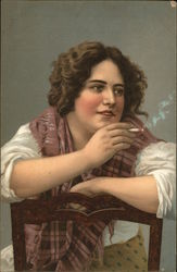 Woman sitting backwards in a chair smoking