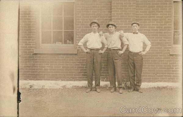 Snapshot of Three Men Outside Brick Building