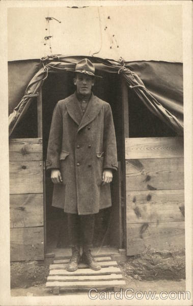 Soldier Posing at the Entrance to a Tent People in Uniform