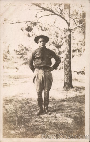 Soldier Posing Under a Tree People in Uniform