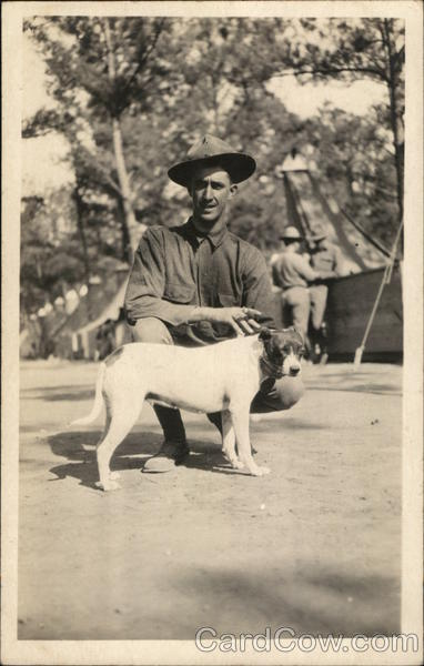 Soldier Posing with Dog People in Uniform Dogs