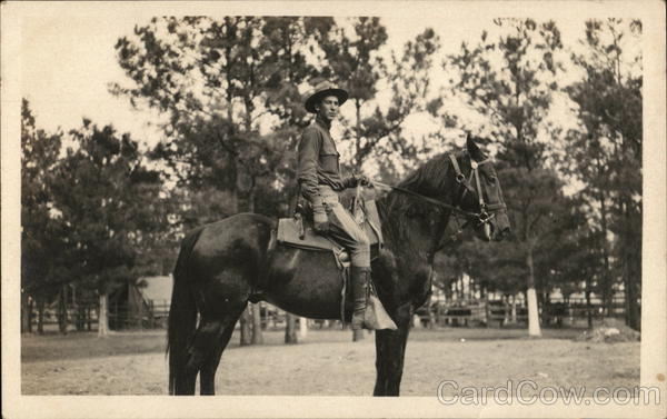 Soldier in Camp Posing on a Horse People in Uniform